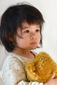 stock photo of teddy  - Small almost two years old child portrait - JPG