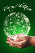 Christmas Card With A Child Hands In Green