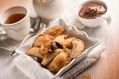 tea cup and cookie stuffed with chocolate cream, selective focus