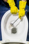 Hand In Protective Yellow Gloves Wash Toilet In The Toilet