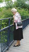 Senior lady on bridge