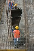 Group of construction workers casting ground floor slab