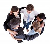 stock photo of huddle  - High angled view of multiethnic businesspeople forming huddle against white background - JPG