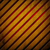 metal plate with gold and red stripes