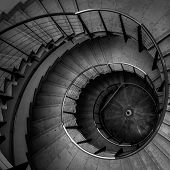 foto of spiral staircase  - Upside view of a spiral staircase angle shot - JPG