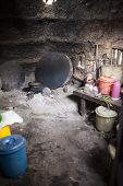 image of mud-hut  - Traditional African kitchen with wood hearth in Ethiopia - JPG