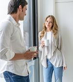 A man and a woman talking in a coffee break