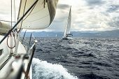 Sailing. Yacht race during stormy weather.