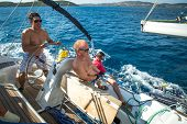 ERMIONI - POROS, GREECE - OCT 9, 2014: Unidentified sailors participate in sailing regatta