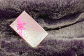 Pink Gift Box On Wool Texture.