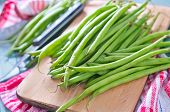 stock photo of green bean  - raw green beans on the wooden board - JPG