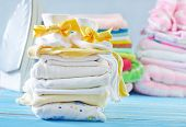 foto of girlie  - baby clothes on a table - JPG