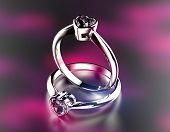 Golden wedding Rings with Diamond heart shape. Jewelry background