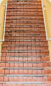 Old Red Tile Steps Up Yellow Plaster Building