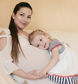 Pregnant Mother With Loving Daughter