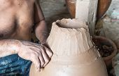picture of molding clay  - The process of molding clay into various shapes - JPG