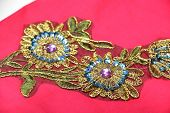 picture of applique  - red material with big golden  flowers applique
