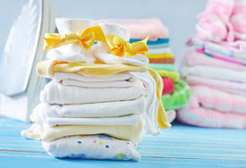 picture of girlie  - baby clothes on a table - JPG