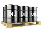 pic of wooden pallet  - Black oil barrels on wooden pallet on white background - JPG