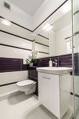 stock photo of shower-cubicle  - Comfortable bathroom in white and violet style - JPG