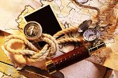 image of spyglass  - Marine still life spyglass and world map on old wooden background - JPG