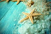 foto of sea salt  - Sea stars on sea salt on wooden background - JPG