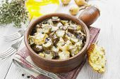 pic of stew pot  - Kidney stewed with potatoes and pickles in a ceramic pot - JPG