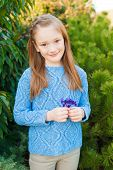picture of pullovers  - Outdoor portrait of a cute little girl of 7 years old - JPG