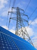 pic of electricity pylon  - Solar panels and electricity pylon against blue sky - JPG