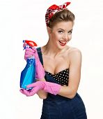 pic of pinup girl  - Smiling cleaning woman wearing pink rubber protective gloves holding blue spray  - JPG