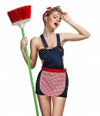 foto of spring-cleaning  - Tired maid standing after spring cleaning with broom  - JPG
