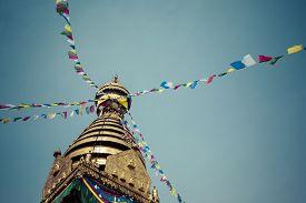 foto of shankar  - Buddha eyes close up with prayer flags at Bodhnath stupa in Kathmandu valley Nepal - JPG