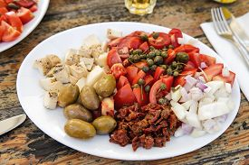 picture of gozo  - Traditional Maltese plates with different ingredients and with Gbejna a small round cheese made in Gozo Malta - JPG