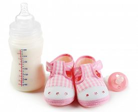 pic of nipples  - Baby shoes with nipple and bottle of milk isolated on white - JPG