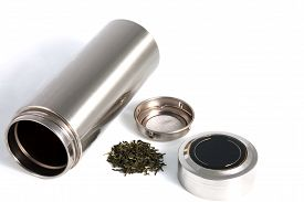 pic of thermos  - Chinese personal thermos with green tea leafs for traditional chinese drink isolated on white - JPG