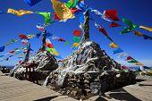 picture of buddhist  - Tibetan buddhist prayer flags on mountain in Shangri - JPG
