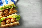 foto of meatball  - Homemade Spicy Meatball Sub Sandwich on wooden table background - JPG