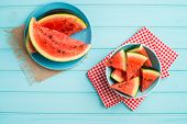 foto of watermelon slices  - Closeup of watermelon slices on wooden vintage background - JPG