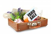 stock photo of old suitcase  - Old suitcase of unwanted stuff ready for yard sale isolated on white - JPG