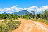foto of sand gravel  - Sand road with cloudy sky - JPG