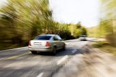 A motion blur image of a speeding car