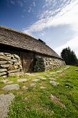 image of longhouse  - A viking longhouse on the coast of Norway - JPG