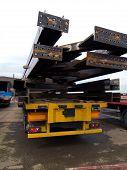 heavy steel beams on trailer