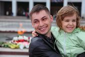picture of jupe  - beautiful little girl and father standing near memorial and smiling - JPG
