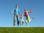 stock photo of happy family  - fly happy family on blue sky - JPG