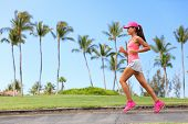 Healthy woman runner jogging on city sidewalk. Happy Fitness girl athlete working out living an acti poster