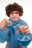 foto of mad scientist  - Funny looking young man playing  - JPG