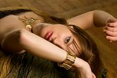 young pretty woman with golden bracelet and necklace