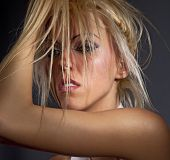Passionate woman fluffing up blond hair