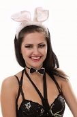 Sexy playgirl with bunny ears isolated on white
